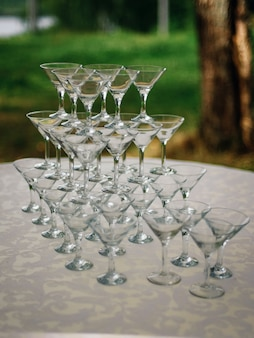 Pyramid of martini glasses on the table