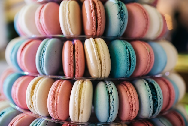 Pyramid of pink, white and blue macaroons