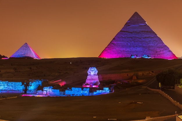 The pyramids and the sphinx in the night lights, giza, egypt.