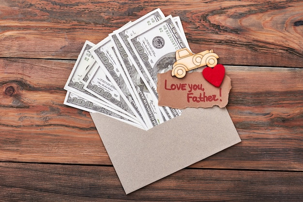 Pyrography car near money. love you father greeting card. make special present for dad.