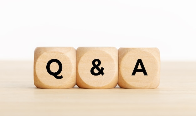Q&a or questions and answers concept. wooden blocks with text on desk. copy space