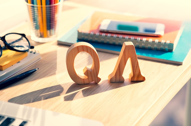Q & a wooden letters on the table