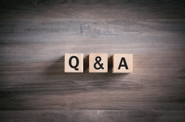 Q and a word with wooden cube. faq-frequently asked questions
