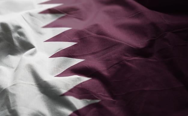 Qatar flag rumpled close up