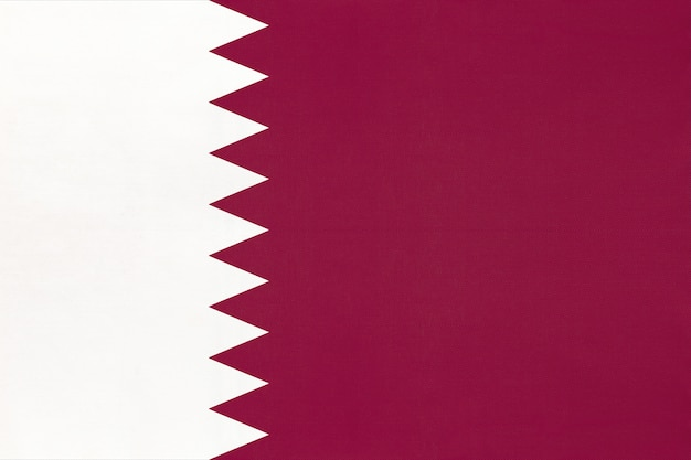 Qatar national fabric flag textile background, symbol of world asian country ,