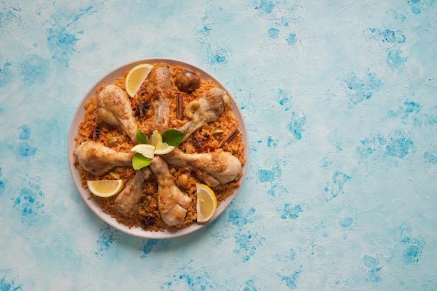 Qatari chicken majboos - national dish of bahrain and qatar. arabic cuisine.