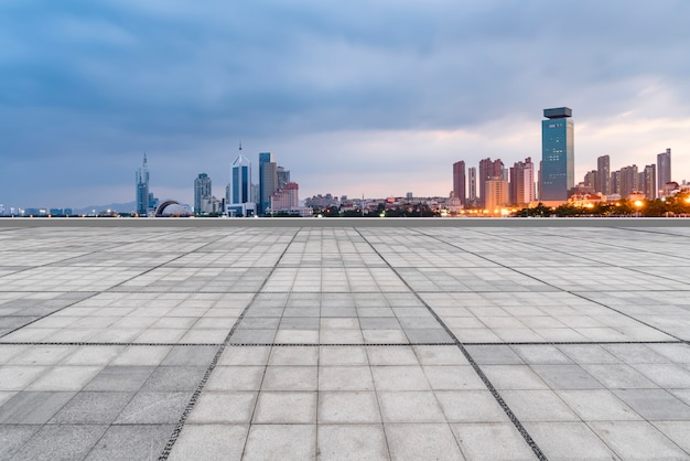 Qingdao city skyscrapers with empty square floor tiles