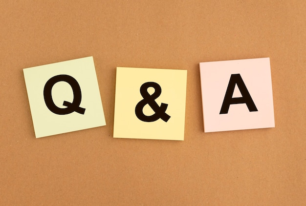 Qna inscription on papers. qa acronym. q concept. questions and answers abbreviation.