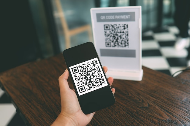 Qr code payment. e wallet. man scanning tag accepted generate digital pay without money.scanning qr code online shopping cashless payment and verification technology concept