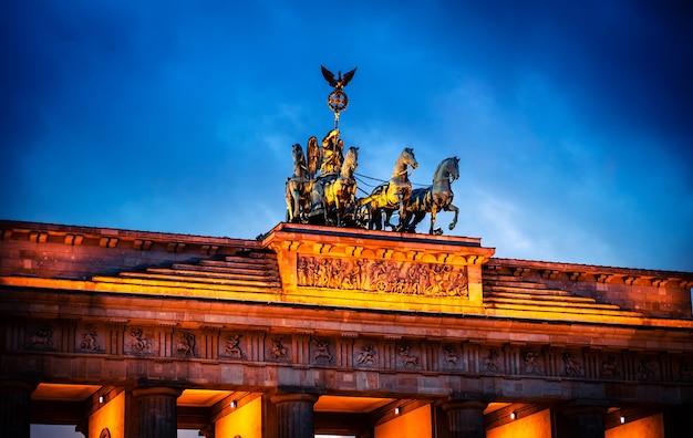 Quadriga on top of brandenburger tor in evening illumination
