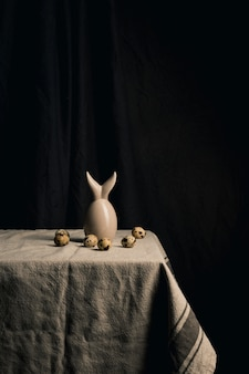 Quail eggs and abstract figure on napkin