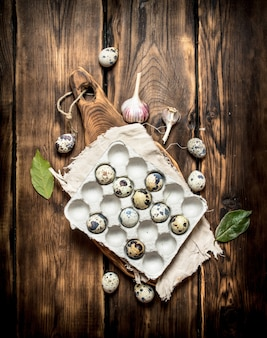 Quail eggs in a box with laurel leaves