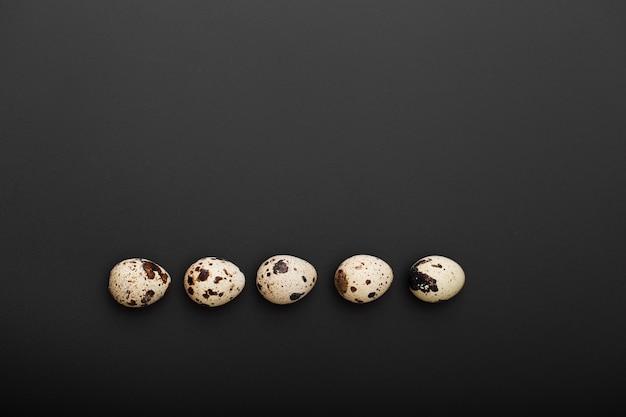 Quail eggs on a dark background