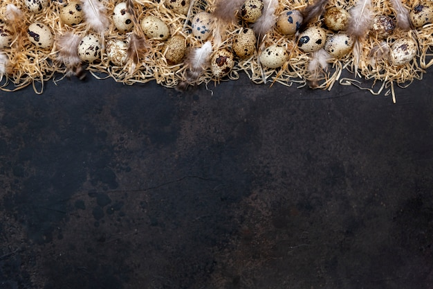Quail eggs on a dark brown surface