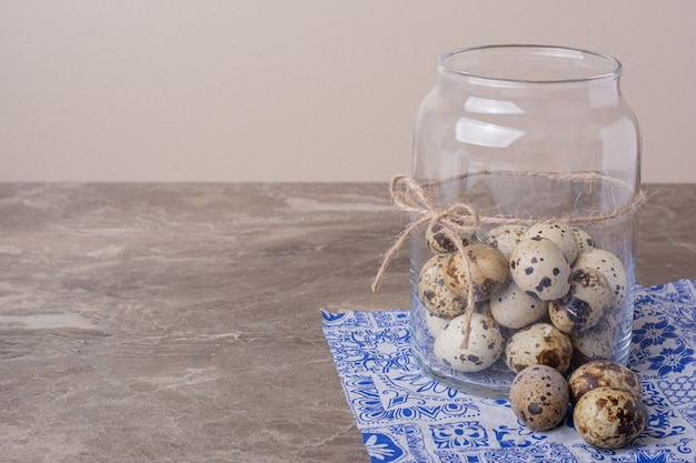 Quail eggs in a glass container jar