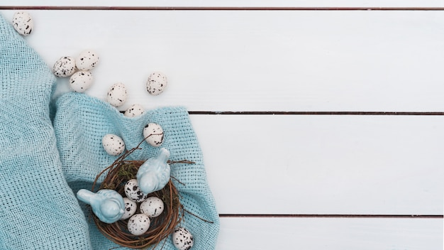 Quail eggs in nest on wooden table