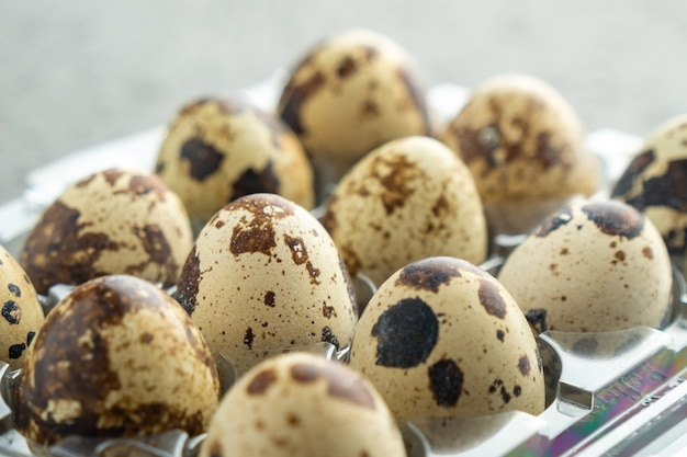 Quail eggs in plastic box, quail eggs background, food