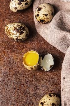 Quail eggs on rustic surface