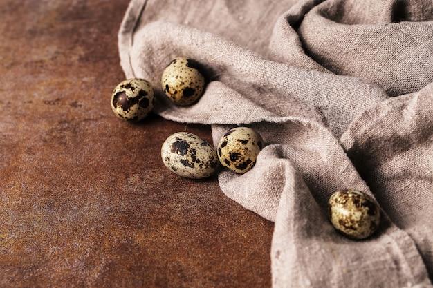 Quail eggs on rustic