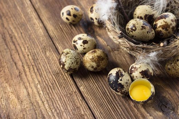 Quail eggs on a wooden table.