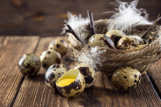 Quail eggs on a wooden table.