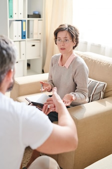 Qualified psychiatrist discussing problems with patient