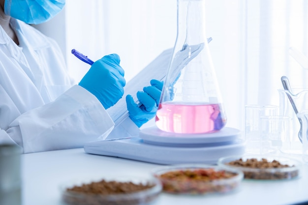 Quality control personnel are inspecting the chemical quality pet food. quality control process and chemical analysis of human and pet food industry.