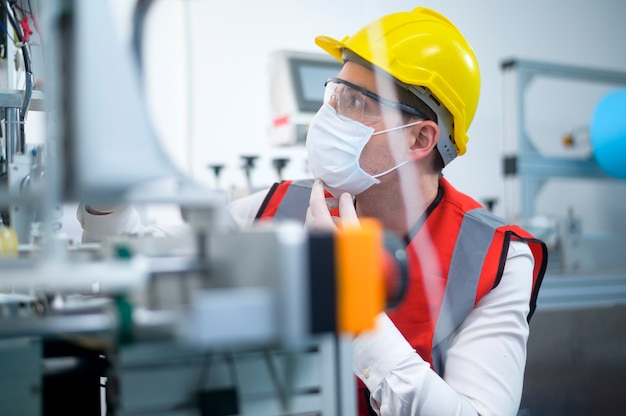 Quality control (qc) engineer monitoring and checking machine system in manufacturing factory