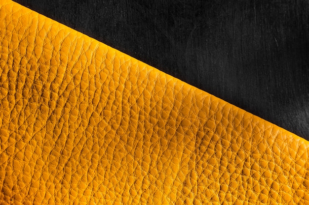 Quality yellow leather material on dark background
