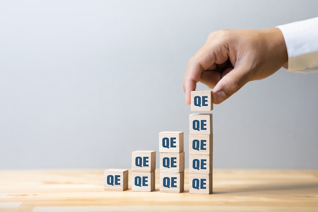 Quantitative easing or economy concepts with qe sign