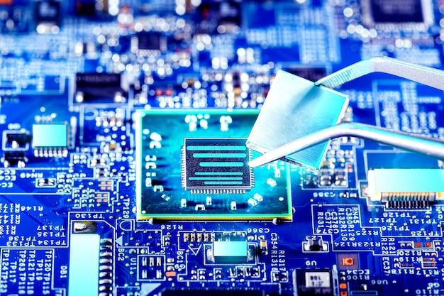 Quantum processor. technician plug in cpu microprocessor to motherboard socket. computer repair.