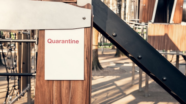 Quarantine advertisement on an empty playground in the park