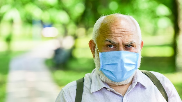 Quarantine extended. easing of lockdown restrictions. pandemic concept. limit risk infection spreading. senior man face mask. older people highest risk covid-19. mask protecting from virus. wear mask.
