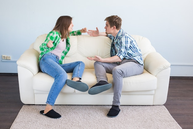 Quarrel, conflict and people concept. woman making gesture while quarreling with her partner