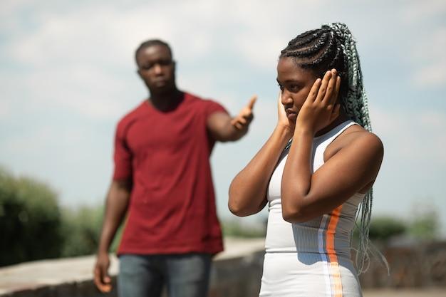 Quarrel between a man and a woman in a summer park