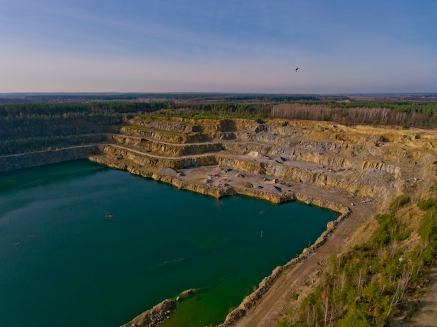 The quarry after the mining of minerals is filled with water. aerial view.