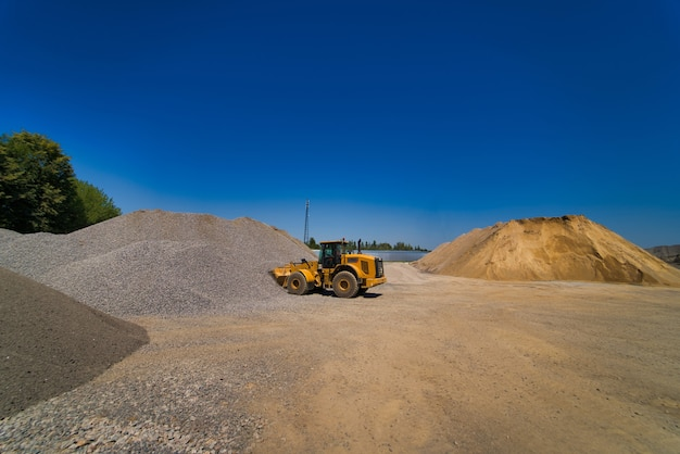 Quarry aggregate with heavy duty machinery.