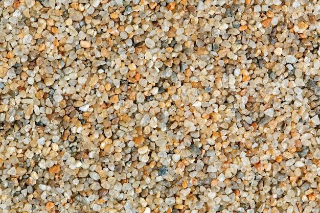 Предпосылка текстуры кварцевого песка. натуральное фото макроса.