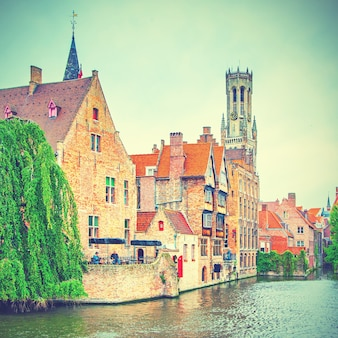 Quay of the rosary (rozenhoedkaai) in bruges, belgium. vintage styole toned