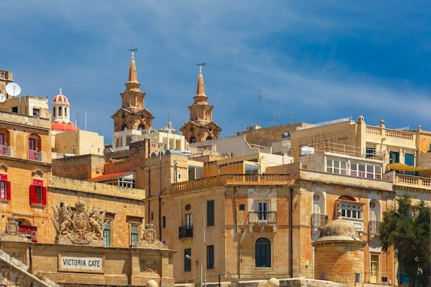 Quay of valletta with traditional maltese building with colorful shutters and balconies in the sunny day, valletta, capital city of malta