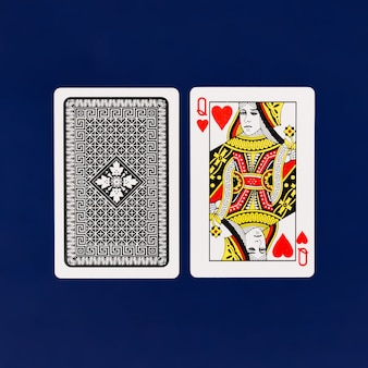 Queen playing cards with plain blue background for poker and casino copyspace
