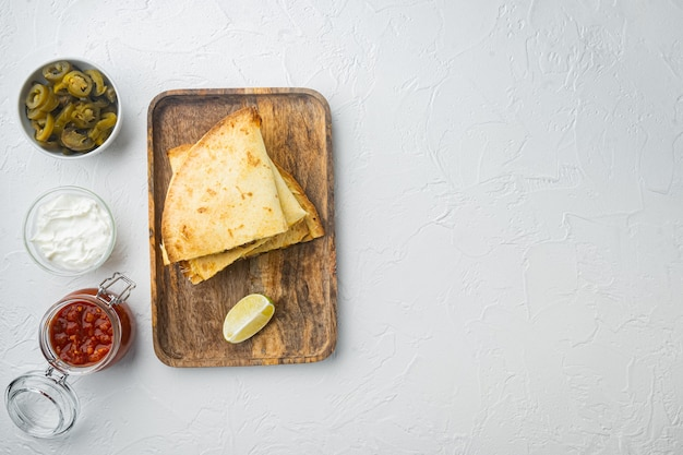 Quesadilla with chicken and sauce, on white background, top view flat lay  with copy space for text