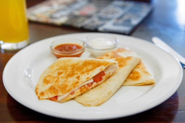 Quesadilla with chicken and tomatoes, two sauce