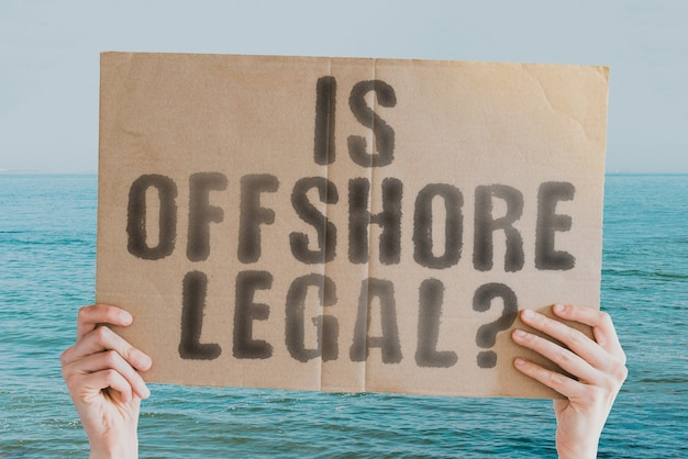 The question if offshore legal  on a banner in mens hand report legality pressure law