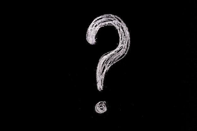 Question mark hand drawn in chalk on a blackboard