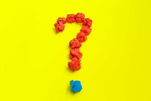 Question mark lined with crumpled paper on yellow  top view copy space