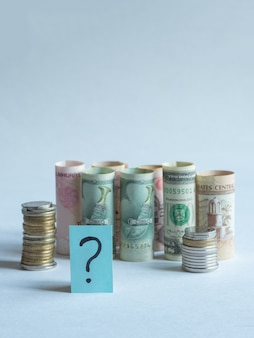 Question mark and money. pandemic and the economic crisis of the concept