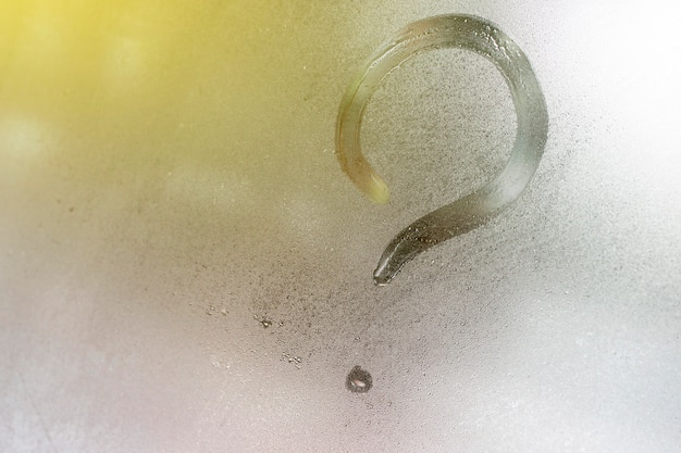 Question mark on the window glass background, toned