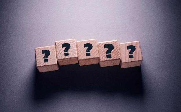 Question mark word written on wooden cubes