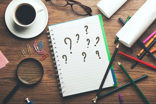 Question mark written on notebook